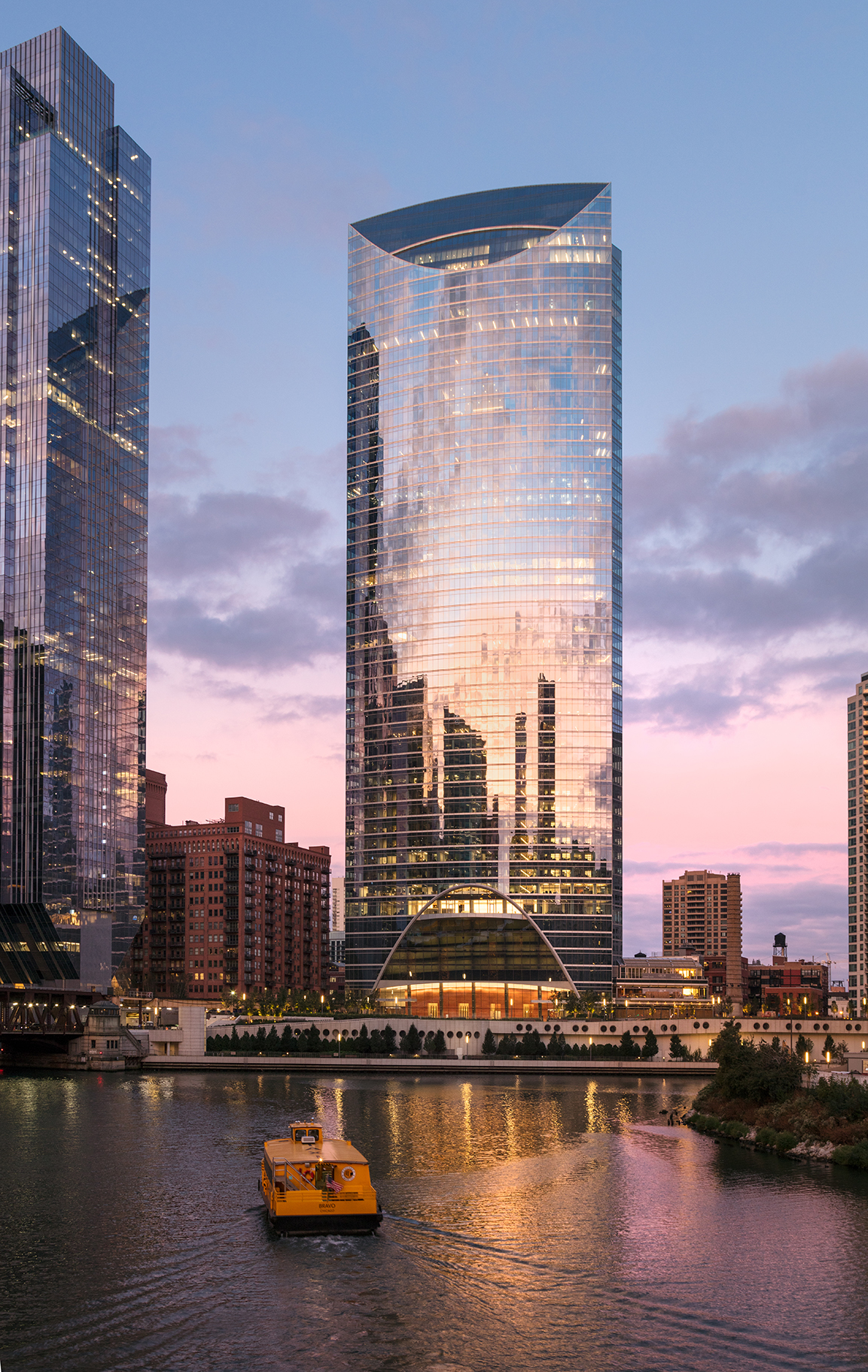 Exterior view of River Point Tower at sunset
