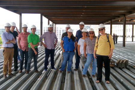 Alvine Engineering staff pose at the 1201 Cass construction site.
