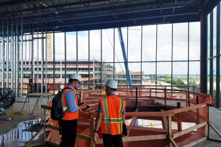 Alvine employees reviewing punch list items at the Eppley Airfield Parking Garage