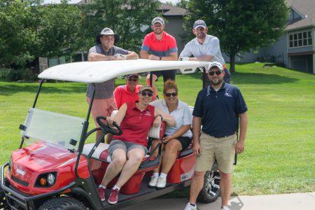Alvine Engineering staff on a golf cart