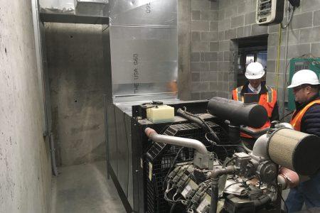 Alvine Engineering staff inspect mechanical equipment at 1201 Cass Street.