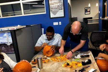 OKC Alvine staff carve pumpkins.
